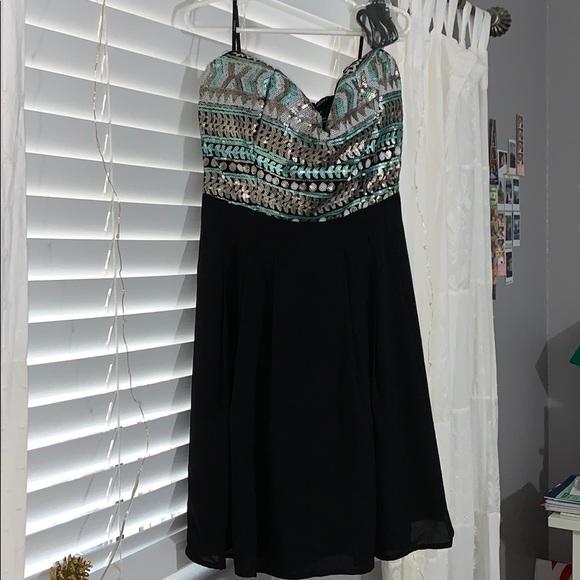 Forever 21 Dresses & Skirts - A mini black dress, never worn!